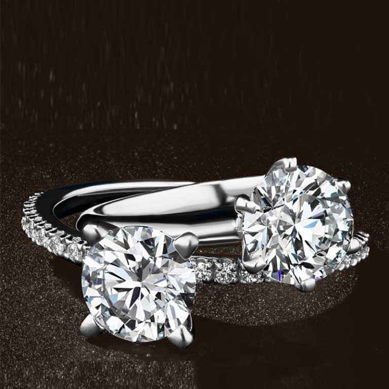 four high quality engagement rings from different angles